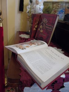 St. Nicholas Books on display in the parlor contain stories from the popular monthly children's magazine from the late 1880s by Scribner's.