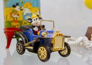 An Image of Mickey in an antique car that was on display in the Disneyana exhibit