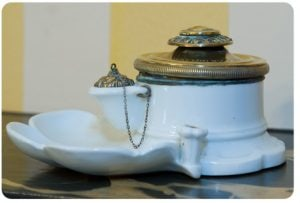 Photo of porcelain inkwell owned by Eugene Field, made in 1894