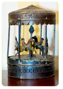 Photo of historic wind-up carousel toy, 1875