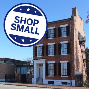 """Promotional image for Small Business Saturday features a picture of the house with a round button that says """"Shop Small"""""""